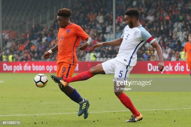 Steven Bergwijn of Holland U21 Joe Gomez of England U21 during the EURO U21 2017 qualifying match between Netherlands U21 and England U21 at the...