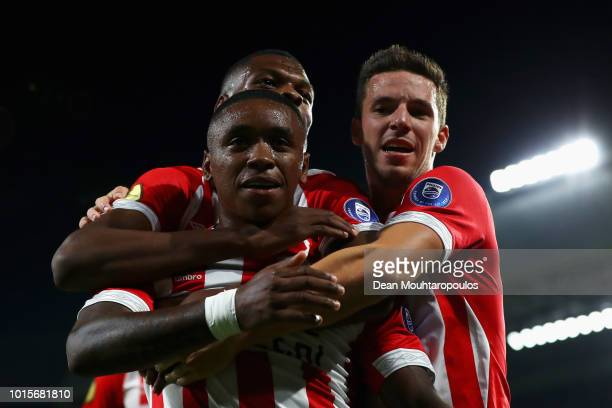 Steven Bergwijn of PSV celebrates scoring his teams second goal of the game with team mates Nick Viergever and Denzel Dumfries during the Eredivisie...