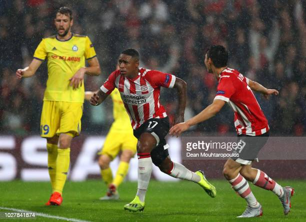Steven Bergwijn of PSV celebrates scoring the first goal during the UEFA Champions League Play-off second leg match between PSV Eindhoven and BATE...