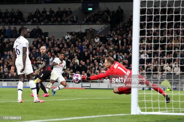 Steven Bergwijn of Spurs shoots but sees his shot saved during the UEFA Champions League round of 16 first leg match between Tottenham Hotspur and RB...