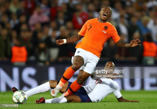Steven Bergwijn of the Netherlands is challenged by Fabian Delph of England during the UEFA Nations League Semi-Final match between the Netherlands...