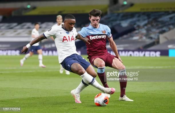 Steven Bergwijn of Tottenham Hotspur and Declan Rice of West Ham during the Premier League match between Tottenham Hotspur and West Ham United at...