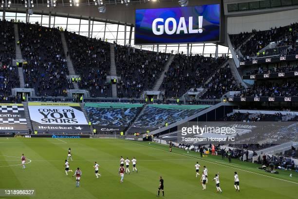 Steven Bergwijn of Tottenham Hotspur celebrates scoring their side's first goal during the Premier League match between Tottenham Hotspur and Aston...