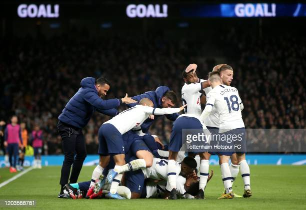 Steven Bergwijn of Tottenham Hotspur celebrates with teammates after scoring his team's first goal during the Premier League match between Tottenham...