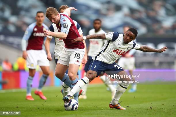 Steven Bergwijn of Tottenham Hotspur in action with Matt Targett of Aston Villa during the Premier League match between Tottenham Hotspur and Aston...