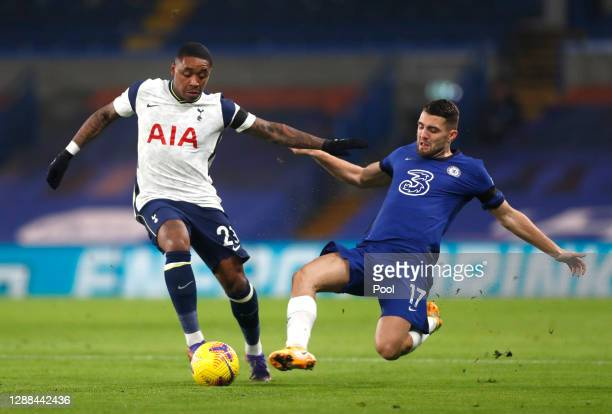 Steven Bergwijn of Tottenham Hotspur is challenged by Mateo Kovacic of Chelsea during the Premier League match between Chelsea and Tottenham Hotspur...