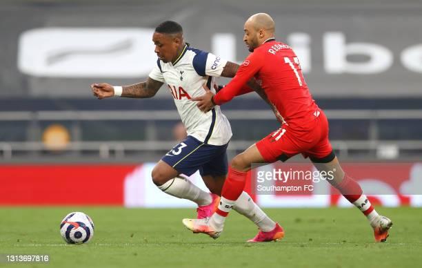Steven Bergwijn of Tottenham Hotspur is challenged by Nathan Redmond of Southampton during the Premier League match between Tottenham Hotspur and...