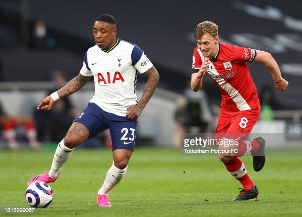 Steven Bergwijn of Tottenham Hotspur runs with the ball whilst under pressure from James Ward-Prowse of Southampton during the Premier League match...