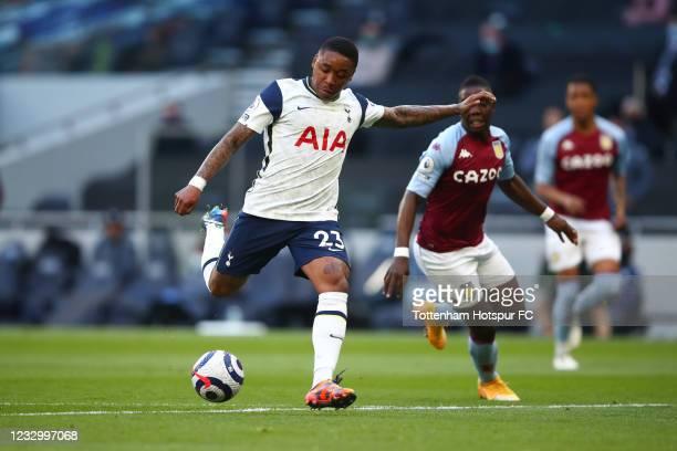 Steven Bergwijn of Tottenham Hotspur scores the opening goal during the Premier League match between Tottenham Hotspur and Aston Villa at Tottenham...