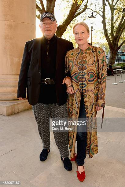 Steven Berkoff and Clara Fisher attend a private view of The Motion Photography Prize exhibition at the Saatchi Gallery on April 16 2014 in London...
