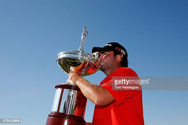 Steven Bowditch of Australia celebrates with the trophy after his fourstroke victory at the ATT Byron Nelson at the TPC Four Seasons Resort Las...