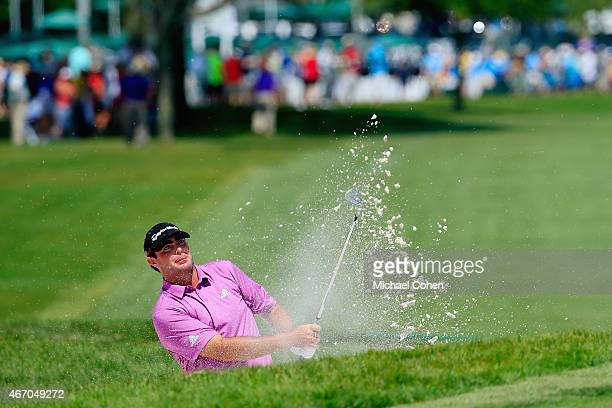 Steven Bowditch of Australia hits a shot from a greenside bunker on the ninth hole during the second round of the Arnold Palmer Invitational...