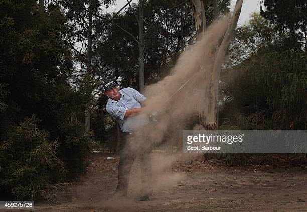 Steven Bowditch of Australia plays a shot on the 18th hole during day one of the 2014 Australian Masters at The Metropolitan Golf Course on November...