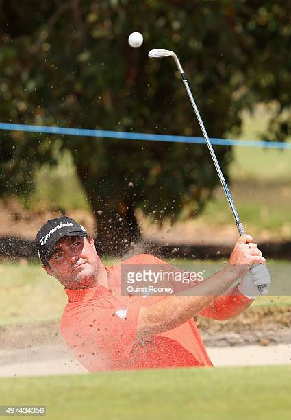 Steven Bowditch of Australia plays out of the bunker during a practice round ahead of the 2015 Australian Masters at Huntingdale Golf Course on...