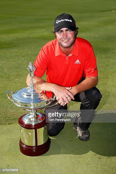 Steven Bowditch of Australia poses with the trophy after his fourstroke victory at the ATT Byron Nelson at the TPC Four Seasons Resort Las Colinas on...