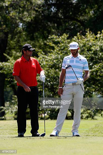 Steven Bowditch of Australia talks with Dustin Johnson on the 12th hole during the Final Round of the ATT Byron Nelson at the TPC Four Seasons Resort...