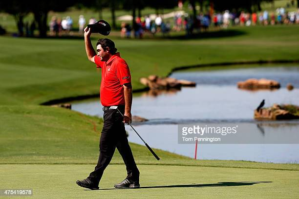Steven Bowditch of Australia tips his hat after winning on the 18th green during the Final Round of the ATT Byron Nelson at the TPC Four Seasons...