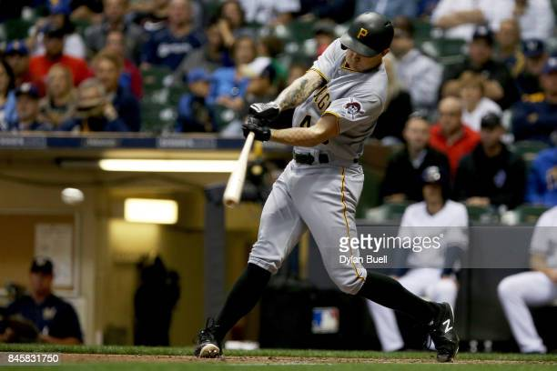 Steven Brault of the Pittsburgh Pirates hits a single in the sixth inning against the Milwaukee Brewers at Miller Park on September 11, 2017 in...