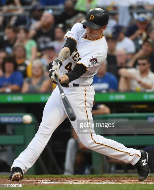Steven Brault of the Pittsburgh Pirates hits an infield single in the third inning during the game against the Milwaukee Brewers at PNC Park on July...