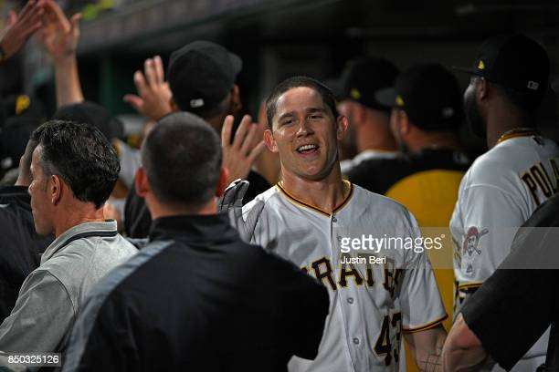 Steven Brault of the Pittsburgh Pirates is met by teammates in the dugout after coming around to score on an RBI triple by Adam Frazier in the fourth...