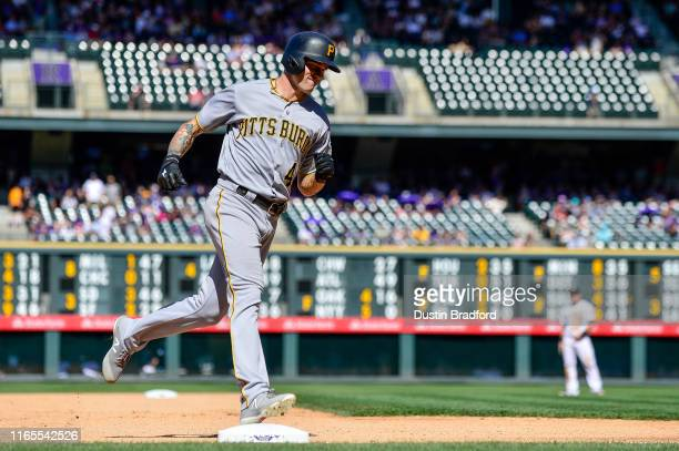 Steven Brault of the Pittsburgh Pirates rounds the bases after hitting a seventh inning solo home run against the Colorado Rockies at Coors Field on...