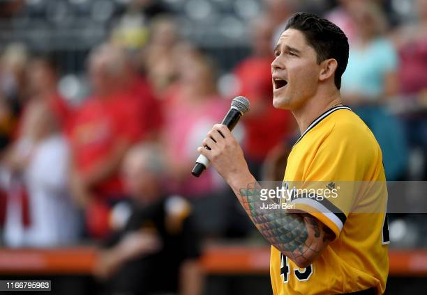 Steven Brault of the Pittsburgh Pirates sings the national anthem before the game against the St. Louis Cardinals at PNC Park on September 8, 2019 in...