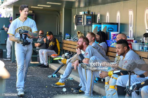 Steven Brault of the Pittsburgh Pirates smiles as he walks through the dugout ignored by teammates after hitting his first career home run against...