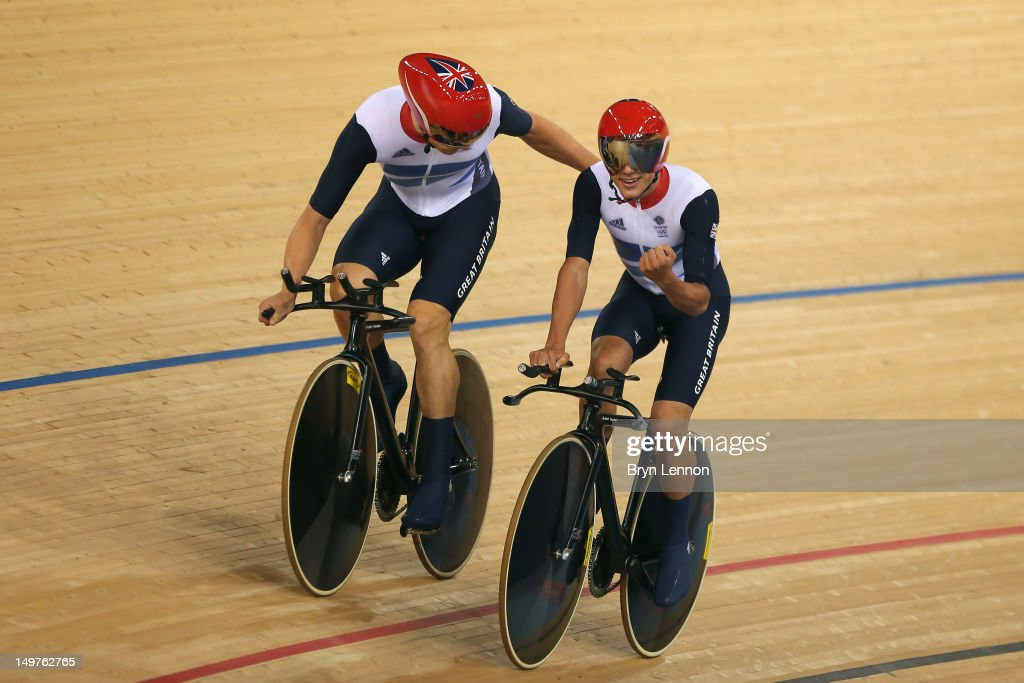 Steven Burke and Peter Kennaugh of Great Britain celebrate winning gold and setting a new world record in the Men's Team Pursuit Track Cycling final on Day 7 of the London 2012 Olympic Games at Velodrome on August 3, 2012 in London, England.