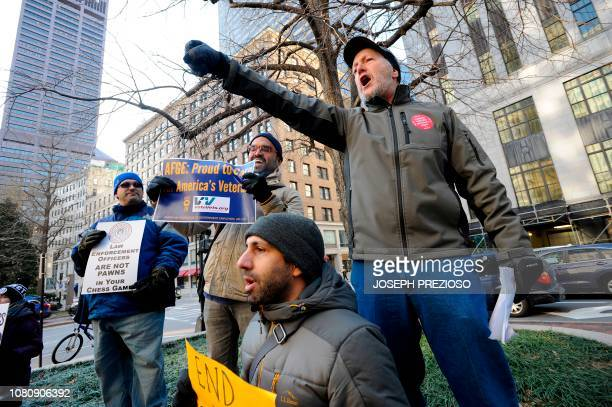 Steven Calder AFGE Union Leader for the EPA leads the chants during a rally and protest by government workers and concerned citizens against the...