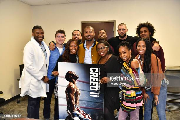 Steven Caple Jr Michael B Jordan and Florian Munteanu pose with student journalists from surrounding Atlanta metro university/college system student...