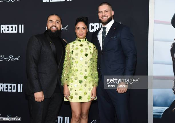 Steven Caple Jr Tessa Thompson and Florian Munteanu attend the 'Creed II' New York Premiere at AMC Loews Lincoln Square on November 14 2018 in New...