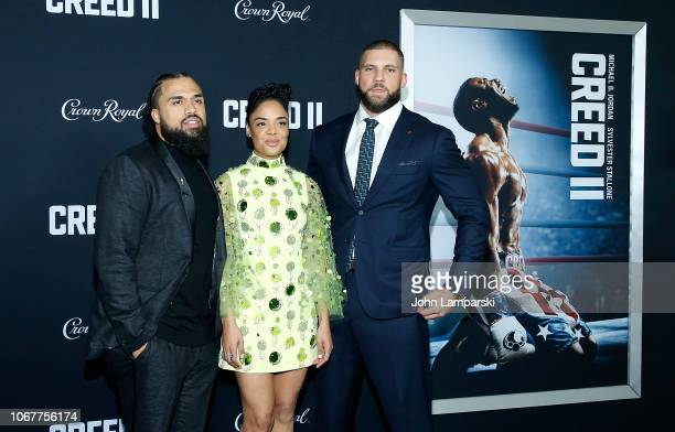 Steven Capole Jr Tessa Thompson and Florian Munteanu attend Creed II New York Premiere at AMC Loews Lincoln Square on November 14 2018 in New York...