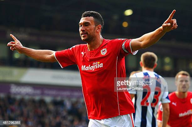 Steven Caulker of Cardiff City celebrates after scoring their second goal during the Barclays Premier League match between West Bromwich Albion and...