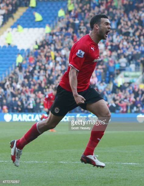 Steven Caulker of Cardiff City celebrates as he scores their second goal during the Barclays Premier League match between Cardiff City and Fulham at...