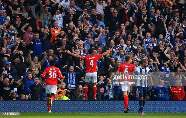 Steven Caulker of Cardiff City celebrates infront of the Cardiff City fans after scoring their second goal during the Barclays Premier League match...