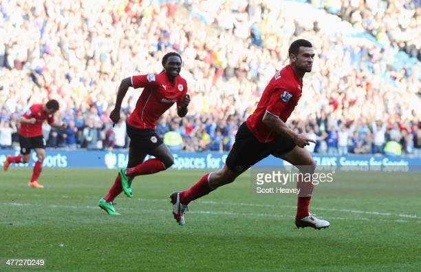 Steven Caulker of Cardiff City celebrates with Kenwyne Jones as he scores their second goal during the Barclays Premier League match between Cardiff...