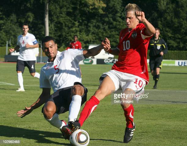 Steven Caulker of England tackles Christoff Knasmullner of Austria during the UEFA European Under19 Championship Final Tournament Group A match...