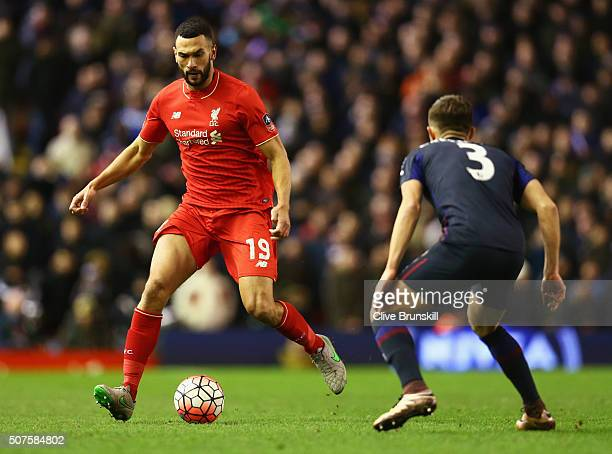Steven Caulker of Liverpool is watched by Aaron Cresswell of West Ham United during the Emirates FA Cup Fourth Round match between Liverpool and West...