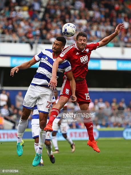 Steven Caulker of QPR and Lukas Jutkiewicz of Birmingham City in action during the Sky Bet Championship match between Queens Park Rangers and...