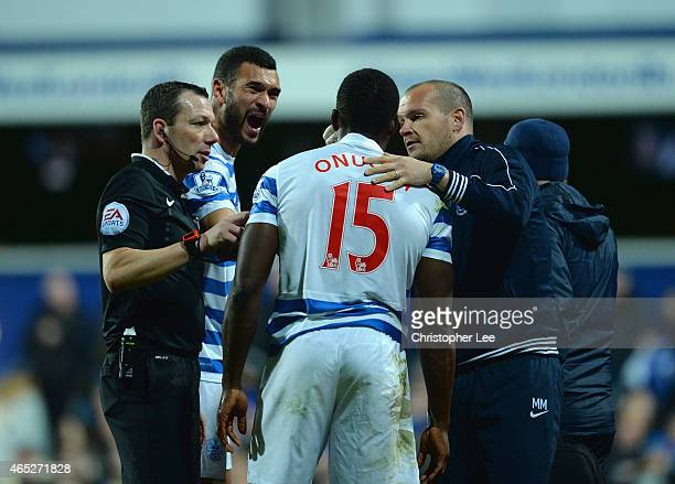 Steven Caulker of QPR seems to pulls a face as he looks at the injury of Nedum Onuoha of QPR after they clash heads during the Barclays Premier...