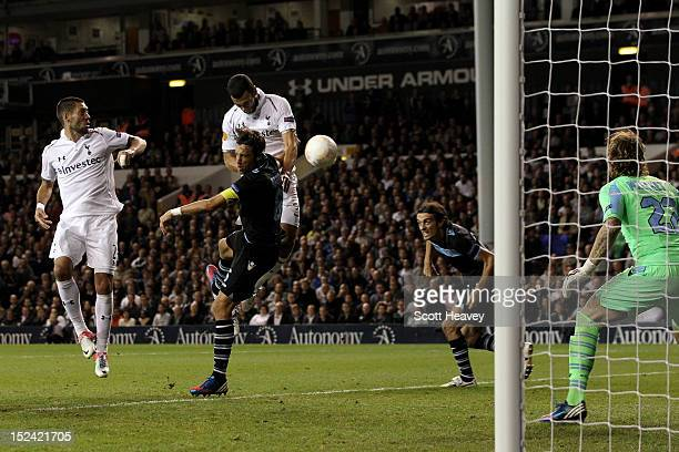 Steven Caulker of Spurs rises above Stefano Mauri of Lazio to put the ball in the net only for the goal to be disallowed by Referee Ovidiu Alin...