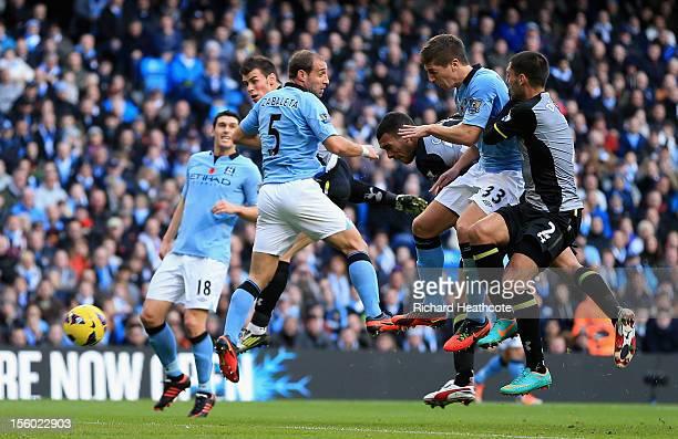Steven Caulker of Tottenham Hotspur scores the opening goal during the Barclays Premier League match between Manchester City and Tottenham Hotspur at...