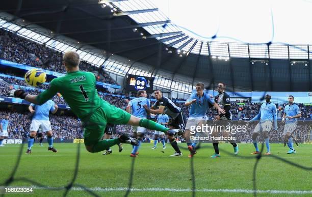 Steven Caulker of Tottenham Hotspur scores the opening goal past Joe Hart of Manchester City during the Barclays Premier League match between...