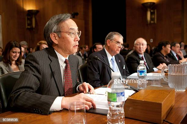 Steven Chu, U.S. Energy secretary, left, testifies at a hearing of the Senate Environment and Public Works Committee on global climate change with...
