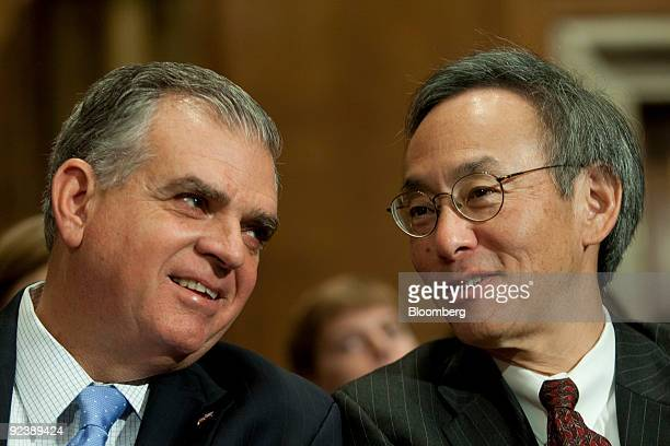 Steven Chu, U.S. Energy secretary, right, speaks with Ray LaHood, U.S. Transportation secretary, before a hearing of the Senate Environment and...