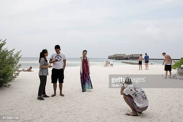 Steven Cindy and David who are part of the airline crew for Capital airlines chat with Li a guest relations officer at the beach on February 02 2016...