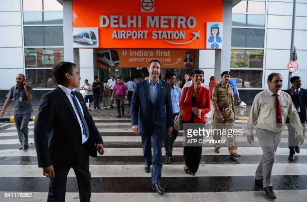 Steven Ciobo Australian Minister for Trade Tourism and Investment and Harinder Sidhu Australia's High Commissioner to India walk outside a metro...