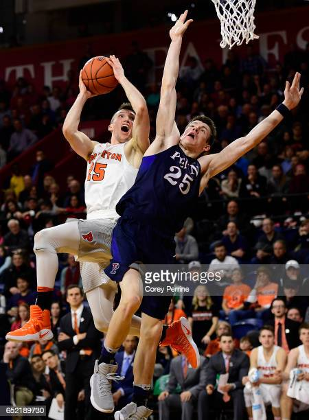 Steven Cook of the Princeton Tigers is fouled by AJ Brodeur of the Pennsylvania Quakers during the second half at The Palestra during a Ivy League...