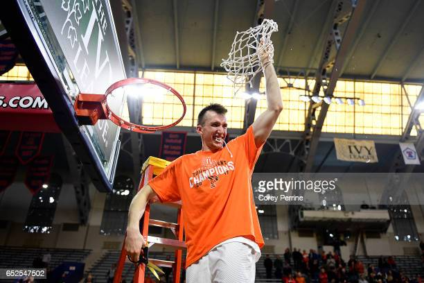 Steven Cook of the Princeton Tigers is the last to cut down the whole net after the win against the Yale Bulldogs in the Ivy League tournament final...