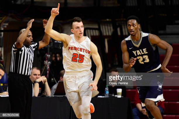 Steven Cook of the Princeton Tigers reacts to a score as Jordan Bruner of the Yale Bulldogs runs along side during the first half of the Ivy League...